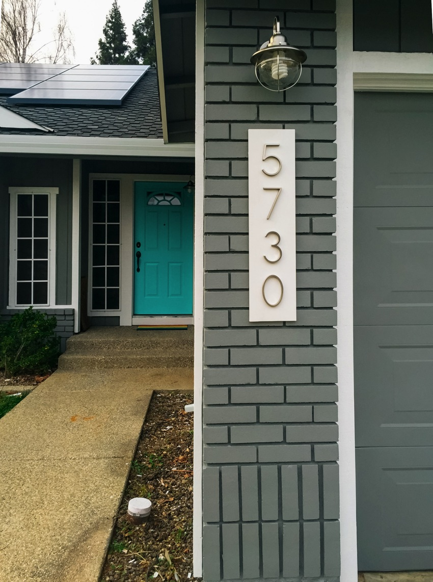 Modern house numbers on white 033